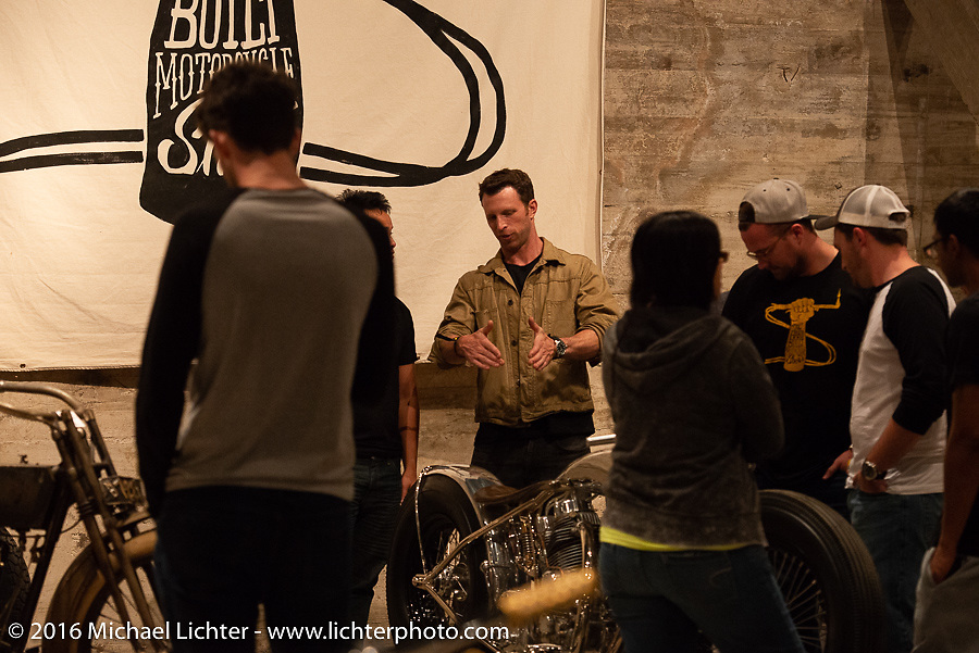 """Max Hazan talks to visitors about his amazing """"Musket"""" (a custom twin engine Royal Enfield) on Saturday in the Handbuilt Motorcycle Show. Austin, TX, USA. April 9, 2016.  Photography ©2016 Michael Lichter."""