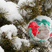 A Christmas ornament hanging in a snow-covered pine. Montana
