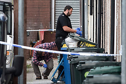 © Licensed to London News Pictures.  20/09/2017; Newport, UK. Police are seen entering a house in Jeffrey Street. Police have closed off streets in Newport and are searching a property in Jeffrey Street, after a third man was arrested on 19 September over last week's Tube attack in Parsons Green. The 25-year-old was arrested in Newport, south Wales, on Tuesday evening, Scotland Yard said. Picture credit : Simon Chapman/LNP