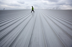 IBC. View of worker walking across the roof of the IBC. Picture taken on 23 Feb 2010 by David Poultney.