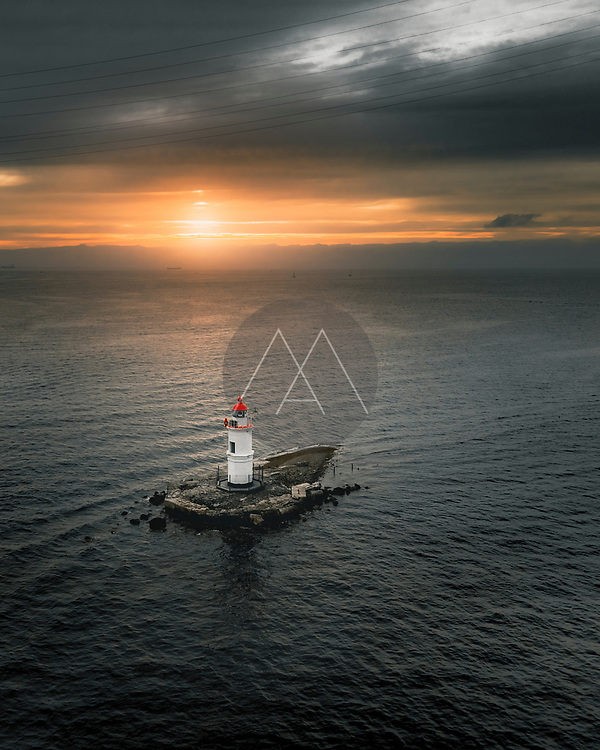 Aerial view of lighthouse at sunset near Vladivostok, Russia.