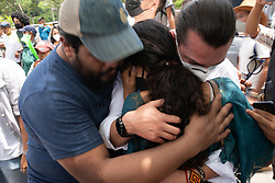 Bertita Cáceres is hugged by friends and family outside the supreme court in Tegucigalpa as sentence is passed on David Castillo for the assassination of Berta Cáceres, her mother.