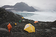 Dr. Tad Pfeffer, a glaciologist with the University of Colorado, walks through camp, set overlooking the Columbia Glacier, near Valdez, Alaska.