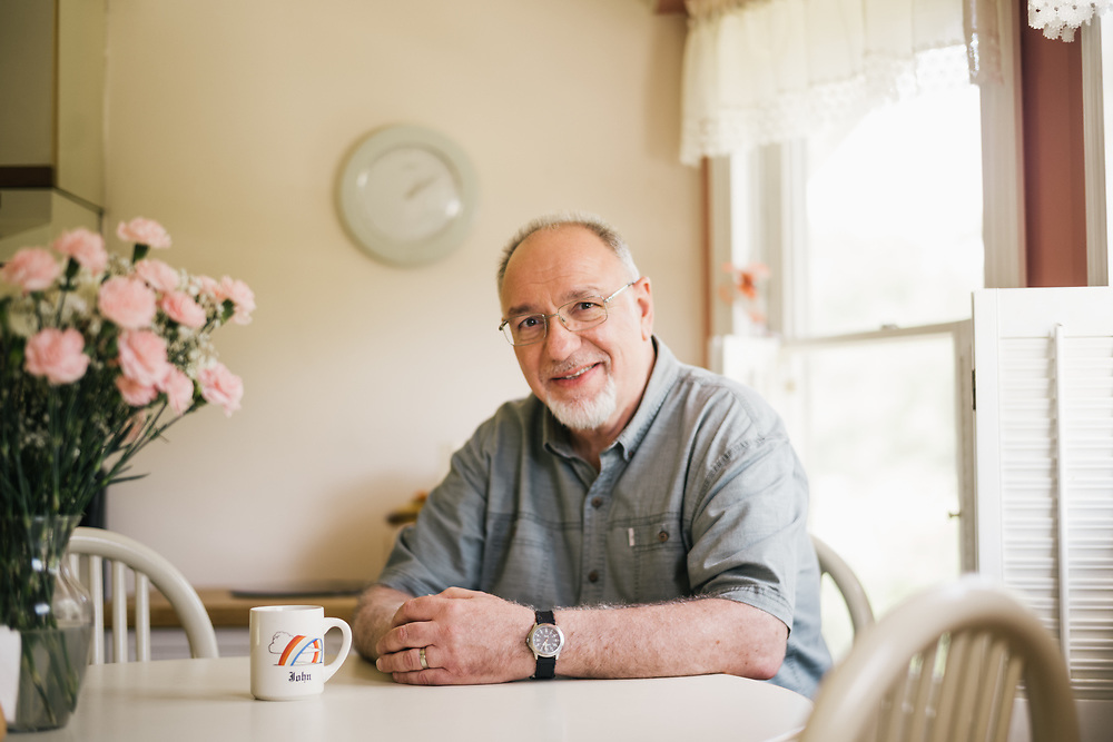 PATCHOGUE, NY –JUNE 27, 2019: John Tanzi sits at his dining room table.