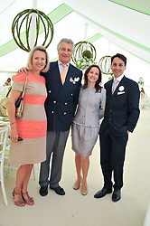 Left to right, ARNAUD & CARLA BAMBERGER, FRANCOIS &  LIUDMILA LE TROQUER at the 27th annual Cartier International Polo Day featuring the 100th Coronation Cup between England and Brazil held at Guards Polo Club, Windsor Great Park, Berkshire on 24th July 2011.