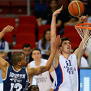 Anadolu Efes's Emircan Kosut (R) during their Turkish Basketball League Play Off round 1 match Anadolu Efes between Turk Telekom at Abdi Ipekci Arena in Istanbul Turkey on Wednesday 20 May 2015. Photo by Aykut AKICI/TURKPIX