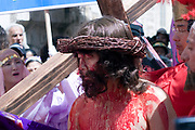 Israel, Jerusalem The Via Dolorosa Procession, Good Friday, Easter 2007 South Korean Pilgrims Re enacting Jesus covered in blood, bearing the Cross on his way to crucifixion. April 2007