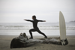 July 21, 2019 - Surfer Stretching On Beach, Cox Bay Near Tofino, British Columbia, Canada (Credit Image: © Deddeda/Design Pics via ZUMA Wire)