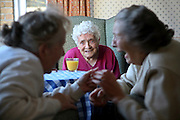 Elderly ladies chatting and laughing at the Neighbourly Care day centre in Southall.