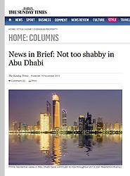 The Sunday Times newspaper; Night skyline of Abu Dhabi