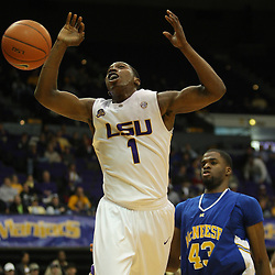 Jan 04, 2010; Baton Rouge, LA, USA;  LSU Tigers forward Tasmin Mitchell (1) reacts after being fouled by McNeese State Cowboys forward P.J. Alawoya (43) during the first half at the Pete Maravich Assembly Center.  Mandatory Credit: Derick E. Hingle-US PRESSWIRE