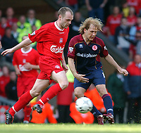 Photo: Daniel Hambury<br /> Barclaycard Premiership. Liverpool V Middlesborough   2/5/2004.  <br /> <br /> Liverpool's Danny Murphy and Middlesborough's Giazka Mendieta