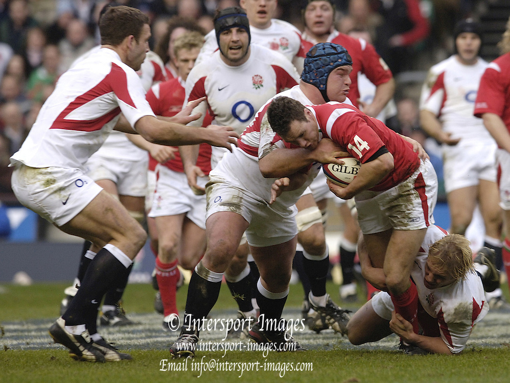 Mark Jones is tackled by Lewis Moody [ground] and Matt Stevens, as England defeat Wales in the 2006 RBS Six Nations Match, [England vs Wales], at Twickenham, by 47 points to 13 on the 04.02.2006.   © Peter Spurrier/Intersport Images - email images@intersport-images mob +44[0]7973 819 551..   [Mandatory Credit, Peter Spurier/ Intersport Images].