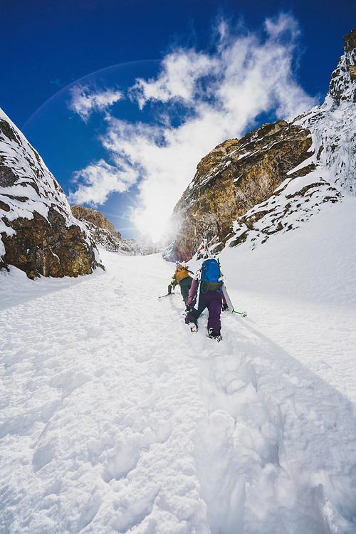 Lani Bruntz, and Mali Noyes boot up the JC Couloir, Sawtooth Range, Idaho.