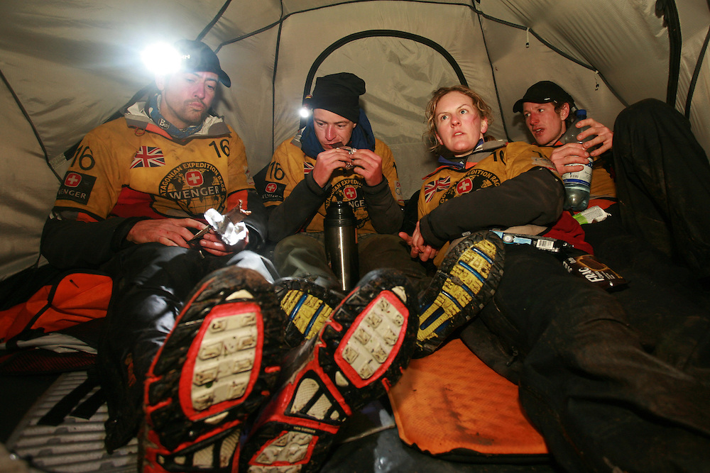 The British Team Helly Hansen Prunesco in a tent after winning the 2009 Wenger Patagonia Expedition Race in Patagonia, Chile, South America L to R Andy Wilson, Mark Humphrey, Nicola Macleod, Bruce Duncan..Copyrighted work .Permission must be sought before use of this image..Alex Ekins .0114 2630277.07901883 994
