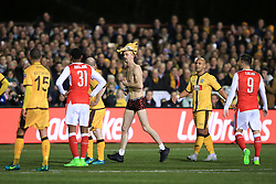 20 February 2017 - The FA Cup - (5th Round) - Sutton United v Arsenal - Players look on at a pitch invader - Photo: Marc Atkins / Offside.