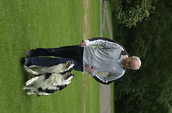 Eddie Sander with his Dogs Jackson and Inka<br /><br />18 June 2004<br /><br />Copyright Paul David Drabble<br /> [#Beginning of Shooting Data Section]<br />Nikon D1 <br /> Focal Length: 80mm<br /> Optimize Image: <br /> Color Mode: <br /> Noise Reduction: <br /> 2004/06/18 09:40:10.4<br /> Exposure Mode: Manual<br /> White Balance: Auto<br /> Tone Comp: Normal<br /> JPEG (8-bit) Fine<br /> Metering Mode: Center-Weighted<br /> AF Mode: AF-S<br /> Hue Adjustment: <br /> Image Size:  2000 x 1312<br /> 1/200 sec - F/7.1<br /> Flash Sync Mode: Not Attached<br /> Saturation: <br /> Color<br /> Exposure Comp.: 0 EV<br /> Sharpening: Normal<br /> Lens: 80-200mm F/2.8<br /> Sensitivity: ISO 200<br /> Image Comment: <br /> [#End of Shooting Data Section]