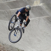Connor Jaine, 15, from Timaru in action during the Gorge Road Mega Jam, for BMX and Mountain Bike riders to mark the opening  of the Gorge Road Jump Park run by the Queenstown Mountain Bike Club,  Queenstown, New Zealand. 3rd December 2011. Photo Tim Clayton