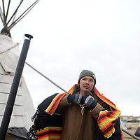 Chanse Helek Zavalla wraps a Pendleton blanket around himself when he walks out of his teepee Tuesday at the Dakota Access Pipeline protest camp in Standing Rock, ND.