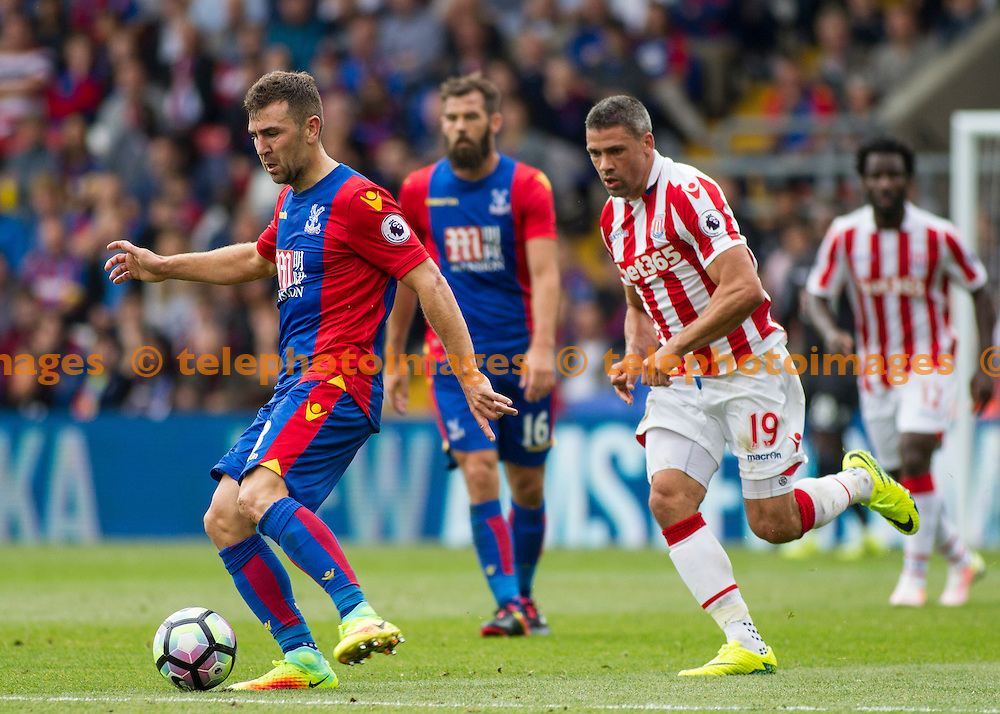James McArthur fends off Jonathan Walters during the Premier League match between Crystal Palace and Stoke City at Selhurst Park in London. September 18, 2016.<br /> Jack Beard / Telephoto Images<br /> +44 7967 642437