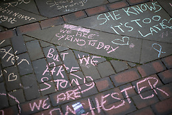 © Licensed to London News Pictures . 22/05/2019. Manchester, UK . People write dedications in coloured chalk on the pavement in St Ann's Square in Manchester City Centre on the second anniversary of the Manchester Arena bombing following a private service in St Ann's Church . On the evening of 22nd May 2017 , Salman Abedi murdered 22 people and seriously injured dozens more , when he exploded a bomb in the foyer of the Manchester Arena as concert-goers were leaving an Ariana Grande gig . Photo credit: Joel Goodman/LNP