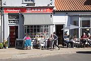 Street cafe people sitting outside, Aldeburgh, Suffolk, England, UK