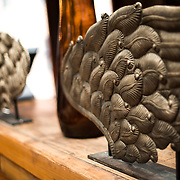 Bronzed angel wings being used as interior decoration.
