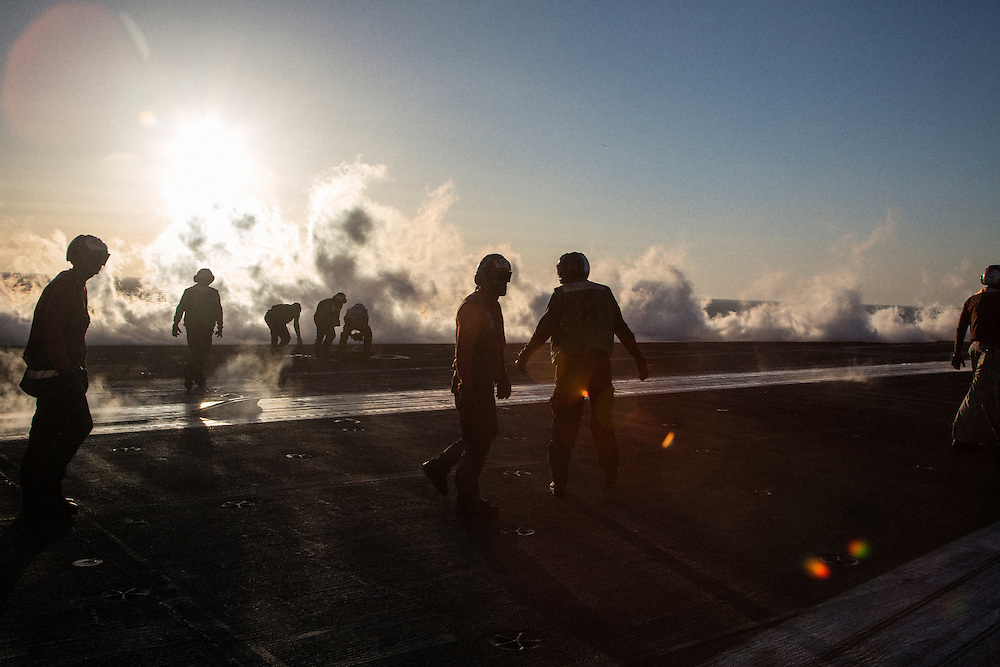 Flight deck crew preparing for the launch of another aircraft from one of the four catapults<br /> <br /> Aboard the USS Harry S. Truman operating in the Persian Gulf. February 25, 2016.<br /> <br /> Matt Lutton / Boreal Collective for Mashable