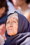 09 APRIL 2004 - SAN MIGUEL DE ALLENDE, GUANAJUATO, MEXICO: A Mexican woman listens to church bells ring before a Good Friday procession to start at the Iglesia Oratorio before a Good Friday procession in San Miguel de Allende, GTO, MEX. Semana Santa, the week before Easter, is celebrated with extreme piety in central Mexico. San Miguel, which was founded in the 1600s, is one of Mexico's premier colonial cities. It has very strict zoning and building codes meant to preserve the historic nature of the city center. About 7,500 US citizens, mostly retirees, live in San Miguel. PHOTO BY JACK KURTZ
