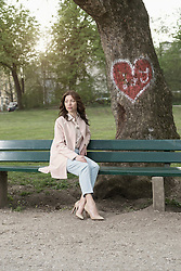 Mature woman waiting for her date on park bench, Bavaria, Germany
