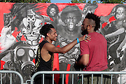 """August 27, 2016- Brooklyn, New York-United States: (L-R) Visual Artists Miguel Ovalle and Coby Kennedy attend and install their artwork during the 2016 AfroPunk Brooklyn Concert Series held at Commodore Barry Park on August 27, 2016 in Brooklyn, New York City. Described by some as """"the most multicultural festival in the US,"""" which includes an eclectic line-up and an audience as diverse as the acts they come to see. <br /> (Photo by Terrence Jennings/terrencejennings.com)"""