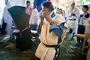 "25 APRIL 2005 - SAN CRISTOBAL DE LAS CASAS, CHIAPAS, MEXICO: A Mayan Indian man prays during a first communion mass in the Chamulan Indian community of Yaaltsunum near San Cristobal de las Casas. The Catholic Church in the Chiapas highlands is facing a threat from evangelical Protestant churches, which are experiencing explosive growth, and from ""traditionalist"" Catholic churches, which are not affiliated with the San Cristobal diocese and are controlled by local politicians and powerful indigenous leaders affiliated with the politicians. The traditionalists burn down churches and chapels affiliated with the diocese, threaten the priests and put indigenous men who worship with the diocese in jail.  PHOTO BY JACK KURTZ"