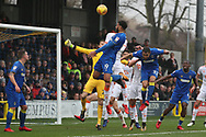 AFC Wimbledon midfielder Tom Soares (19) winning a header in the box during the EFL Sky Bet League 1 match between AFC Wimbledon and Blackpool at the Cherry Red Records Stadium, Kingston, England on 20 January 2018. Photo by Matthew Redman.