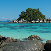 Children snorkeling near Sunrise beach, Ko Lipe, Thailand