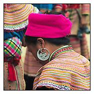 Detail of earring worn by a Flower Hmong woman visiting the Can Cau market near Bac Ha, Vietnam, Southeast Asia