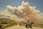 June 20, 2016 - Duarte, California, U.S. - Residents evacuate horses from stables off Fish Canyon Rd as the Fish Fire burns in the background, above Duarte and Los Angeles County. The fire was 1,400 acres at 2:50pm.<br /> ©Exclusivepix Media