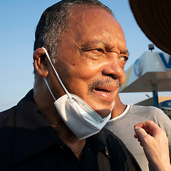 Rev.  JESSE JACKSON, longtime Democratic activist,  looks at the assembled crowd as voting rights groups march toward the Texas Capitol from north Austin on the third day of a 30-mile journey protesting Republican efforts to suppress votes nationwide and in Texas. Shifts of marchers trade off in an effort to combat oppressive Texas heat.