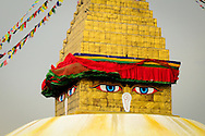Nepal,  Kathmandu. Buddha Eyes on Boudnath Stupa - the main centre of the tibetan buddhism in Nepal.