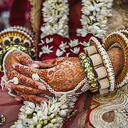 Intricate mehendi and high-fashion designer jewellery bangles (choora) on the bride's hands. Udaipur, 2011