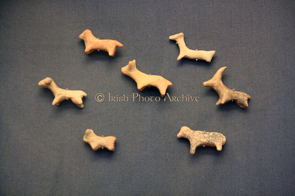 Seven terracotta animal figurines Minoan, 2000-1700 BC (MMI-MMII). These figureines of cattle, sheep a goat and a dog were dedicated at the peak sanctuary of Petaofas in east Crete. It is likely that these were votives dedicated to ensure the welfare of domestic animals.