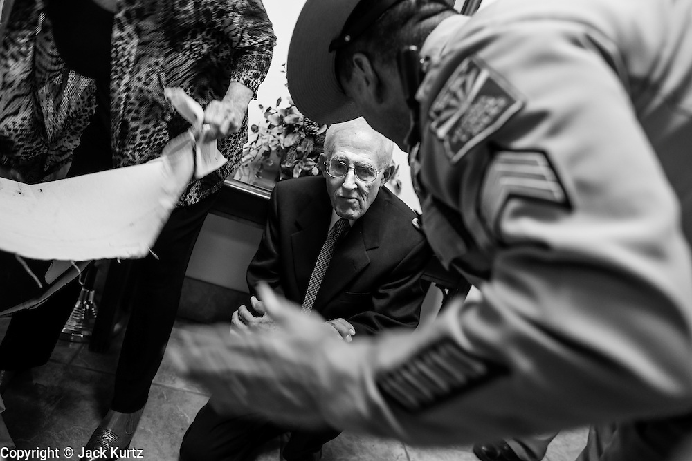 17 OCTOBER 2013 - PHOENIX, AZ:  DON JOHNSON, a retired accountant from Mesa, AZ, is arrested by Arizona Capitol Police in the office of the Attorney General. About 100 people came to the office of Arizona Attorney General Tom Horne to protest the decision by Horne to sue community colleges in Maricopa County that charge DREAM Act students who are residents of Arizona out of state tuition rather than in state resident tuition. Nearly 10 people were arrested in a planned civil disobedience during the protest.   PHOTO BY JACK KURTZ