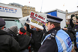 © Licensed to London News Pictures. 12/01/2019. London, UK.Rival protesters tries to enter the rally in Trafalgar Square. <br /> Thousands of people many in yellow vest take part in a demonstration organised by People's Assembly Against Austerity by marching in London and rallying in Trafalgar Square calling for a General Election. Photo credit: Dinendra Haria/LNP