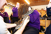 12/11/2018 Repro free: Galway Science and Technology Festival, the largest science event in Ireland, runs from 11-25 November featuring exciting talks, workshops and special events. Full programme at GalwayScience.ie. Pupils   from Our  Lady's College Galway  with a python from The Bug Doctors collection ( Dr Michel Dugon- NUI Galway) Photo:Andrew Downes, Xposure.