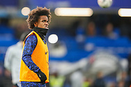 Chelsea midfielder Willian (22) warms up prior to the The FA Cup fourth round match between Chelsea and Sheffield Wednesday at Stamford Bridge, London, England on 27 January 2019.
