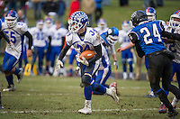Andrew Brothers carries the ball for some yardage during Saturday's NHIAA semi final Football with Winnisquam.  (Karen Bobotas/for the Laconia Daily Sun)
