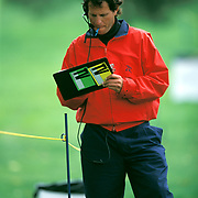 Desperate to cover expenses many caddies, like Andy Davidson, without bags who don't find day work from the parking lot vy for jobs as spotters for TV. It pays $50 per round.
