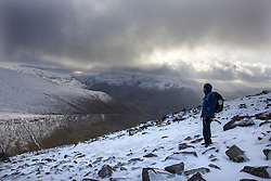 © Licensed to London News Pictures. 30/12/2014.  Elidir Fawr, Wales.   A walkers enjoys one of the peaks in the Snowdon National Park today.  Photo credit : Alison Baskerville/LNP