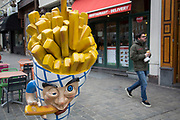 Chips character outise a Belgian frites shop in Brussels, Belgium. The Brussels-Capital Region is a region of Belgium comprising 19 municipalities, including the City of Brussels.