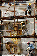 """Construction workers put up a scaffolding by a statue of a Greek mythology figure around the """"Golden Palace"""" night club in Shanghai, China on 14 February, 2011."""