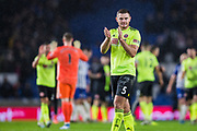 Jack O'Connell (Sheffield United) applauding the Sheffield United FC supporters following the Premier League match between Brighton and Hove Albion and Sheffield United at the American Express Community Stadium, Brighton and Hove, England on 21 December 2019.